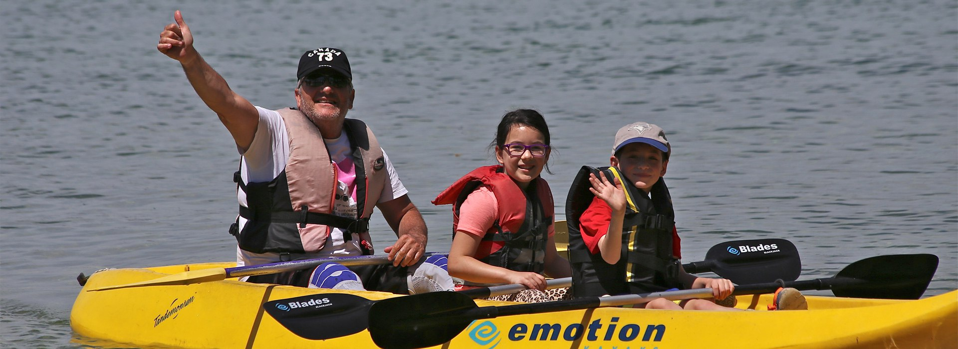 image: Disabled veteran and children in a canoe